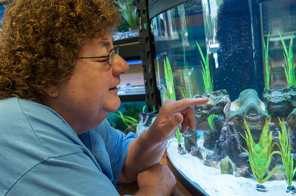 Globe/Roger Nomer<br /> Becky Burress greets a seahorse on Wednesday.