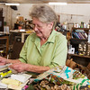 Globe/Roger Nomer<br /> Frances Strickland, owner of Fran's Flea Market, works in Fairland on Tuesday.