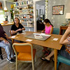 Josie Mai talks about the health benefits of Mediterranean cuisine during a cooking class at her Carthage home on Saturday. From the left: Joy Barnett, Hailey Neighmond, 16 and Brenda Spencer.<br /> Globe | Laurie SIsk
