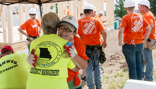 Globe/Roger Nomer<br /> Ellen Letterman, part-time cashier with Home Depot, gives a hug to homeowner Charlotte King while volunteering with Habitat for Humanity on Wednesday.