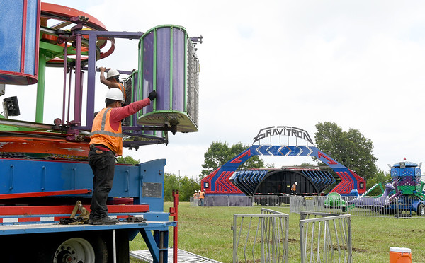 Workers begin to set up rides on the midway on the first day of the Newton County Fair on Wednesday in Neosho.<br /> Globe | Laurie Sisk