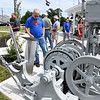Webb City businessman Larry Tamminen checks out a mining hoist at the Cardinal Route 66 Park before dedication ceremonies for the park in Webb City on Thursday. <br /> Globe | Laurie Sisk
