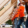 Globe/Roger Nomer<br /> Volunteers with Home Depot help raise a wall on Wednesday while working with Habitat for Humanity in Joplin.