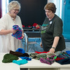 Globe/Roger Nomer<br /> Ann Leach receives donations from Beth Snow, teen services librarian, for Chase the Chill on Monday at the Joplin Public Library.