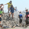 Mudstock participants slog through part of the muddy course during Mudstock on Saturday in Carthage. The annual event is a drug awareness program sponsored by the Alliance of Southwest Missouri, with a course designed by Carthage Fire Department, Carthage Police Department, and the Carthage Caring Communities Coalition.<br /> Globe | Laurie Sisk