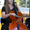 "Cellist Victoria Monge entertains the crowd as she joins her other Saline Fiddlers Philharmonic members during the ""Fiddlers on the Route"" music Festival on Saturday night at Landreth Park. The Connect2Culture event featured the Saline, Mi.-based group along with food and games for the children.<br /> Globe 