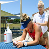 Schifferdecker Pool Manager Maddy Stripling applies sunscreen on the shoulders of lifeguard Brittney Burns on Wednesday at the pool. <br /> Globe | Laurie Sisk