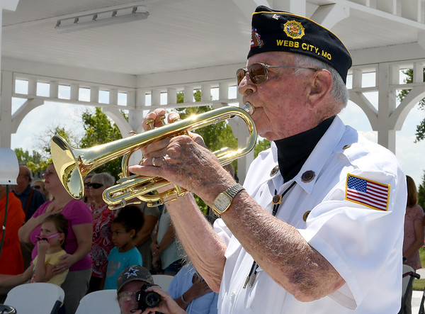 Bruce Benson plays taps during dedication ceremonies for the Cardinal Route 66 Park in Webb City on Thursday. Benson also plays taps each day at sundown near the Webb City Post Office.<br /> Globe | Laurie Sisk