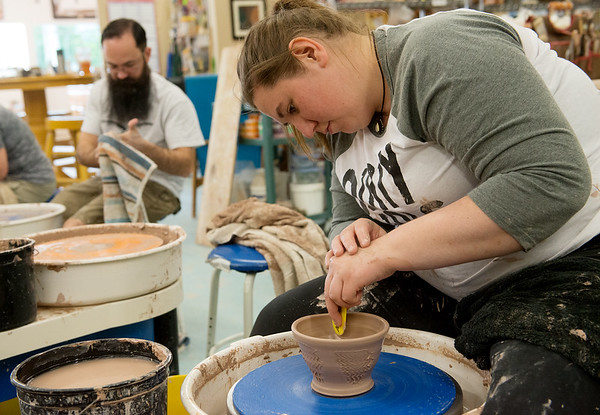 Globe/Roger Nomer<br /> Alex Douglas, Springfield, makes a clay pot at Phoenix Fired Art on Friday.