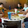 """From the left: Gwyneth Cleveland, 10, Counselor Holly Crane, Lola King, 11, Tatum Polozola, 9 and Karma Hensley, 10, chat Thursday during a planning session for their """"Potter Party"""" - a Harry Potter-themed celebration to commemorate their last night at Camp Mintahama.<br /> Globe 