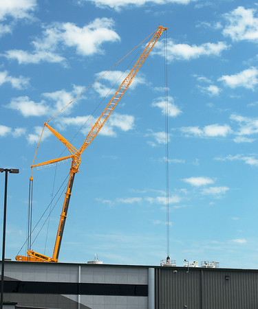 Globe/Roger Nomer<br /> A crane delivers tanks to Jasper Products on Wednesday.