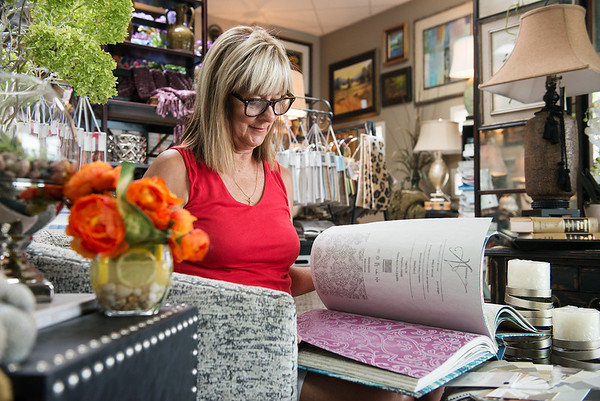 Globe/Roger Nomer<br /> Margie Moss, owner, works on Thursday at the Joplin Decorating Center.