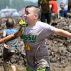 Austin Miles, 11, of Webb City, emerges unscathed, from a mud pit during Mudstock on Saturday in Carthage. The annual event is a drug awareness program sponsored by the Alliance of Southwest Missouri, with a course designed by Carthage Fire Department, Carthage Police Department, and the Carthage Caring Communities Coalition.<br /> Globe | Laurie Sisk
