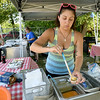 Ghetto Taco's Mischa Martin portions salsa for customer Justin Whittaker, left as Ashley Linder prepares tacos at their pop up food stand on East 7th street on Tuesday.<br /> Globe | Laurie Sisk