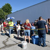 A line begins to form before 5:30 pm food distribution at the Carterville Christian Church's Feed the Heart food pantry on Thursday night. <br /> Globe | Laurie Sisk