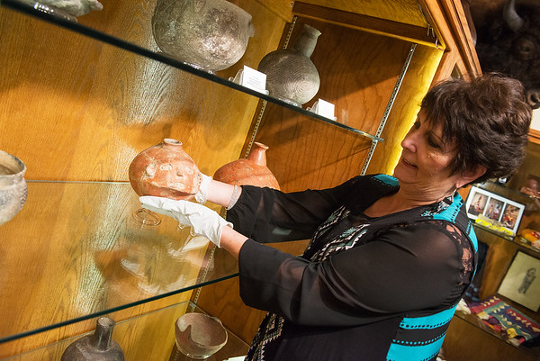 Globe/Roger Nomer<br /> Karen Hildreth, museum registrar, talks about a piece of Quapaw pottery on Friday at the Quapaw Tribal Museum.