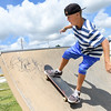 Ryanne Cook works on some skating skills on Thursday afternoon at the Ewert Skate Park. The area enjoyed dryer conditions than the past few days of rain.<br /> Globe | Laurie Sisk