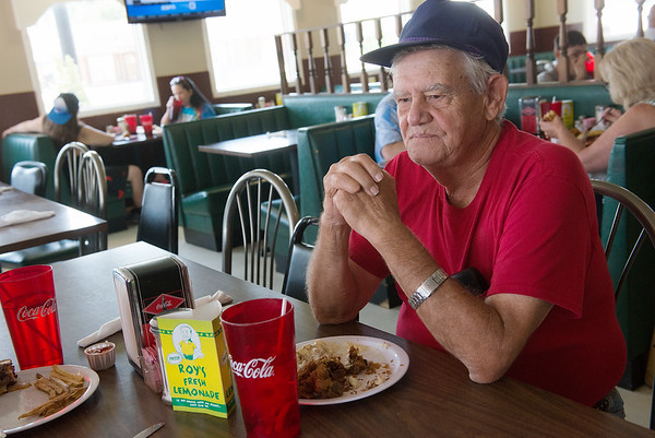 Globe/Roger Nomer<br /> Mack Chandler eats at The Cafe on Tuesday in Fairland.