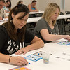 Globe/Roger Nomer<br /> Michelle Moser, left, and Heather Hunt, Carthage, play a round of Bingo on Saturday at the Joplin Public Library.