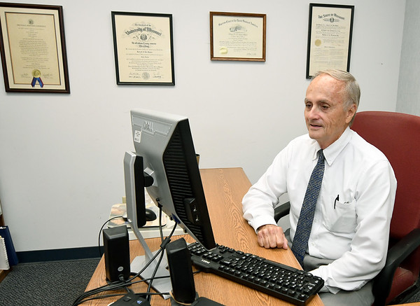 Longtime Jasper County Public Defender Larry Maples works in his Carthage office on Thursday. Maples retires Monday after 35 years of service to Jasper County residents.<br /> Globe | Laurie Sisk