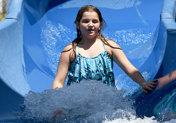 Eleven-year-old Chanley Cumpton cools off with a trip down the slide at Ewert Pool on a hot Friday afternoon.<br /> Globe | Laurie Sisk