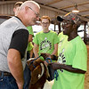 Judge Galen Zook chats with Class LTD client Shirley Luton on Wednesday night as Austyn Simpson of the Shamrock 4H Club looks on during the Herding Heroes event at the Cherokee County Fair in Columbus, Kan.<br /> Globe | Laurie SIsk