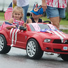 Globe/Roger Nomer<br /> Aayden Wagler, 4, and Natalie Grantham, 3, ride in the Carl Junction Fourth of July Parade on Tuesday.