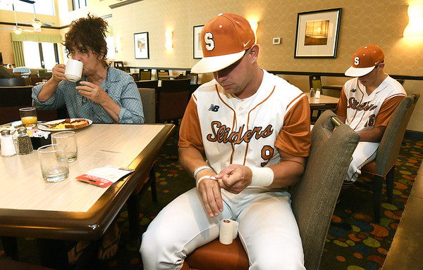 From the left: Carol Smith enjoys her morning coffee at Homewood Suites by Hilton as Texas Sliders players prepare for their first game of the Premier Baseball Tournament at Homewood Suites by Hilton on Wednesday morning.<br /> Globe | Laurie Sisk
