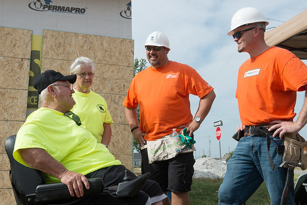 Globe/Roger Nomer<br /> Ron and Charlotte King talk with Kevin Pruitt, center, district manager of Home Depot, and Steven Gandy, store manager of Home Depot Joplin, on Wednesday. The Kings own the home being built in part by Home Depot volunteers.