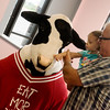 Globe/Roger Nomer<br /> Sadie Magoulas, 2, tentatively greets the Chick-fil-A cow with her grandfather Mike Magoulas on Wednesday during a visit to Tiny Tykes Town.