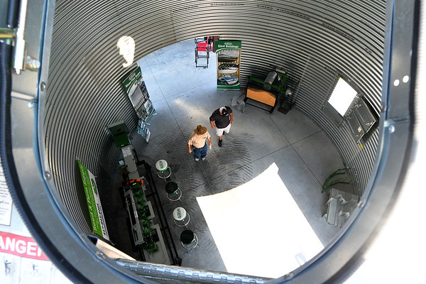 Visitors check out a grain bin on exhibit by Seed & Farm Supply during the first day of the Four States Farm Show on Friday in Pittsburg. The show continues through Sunday.<br /> Globe | Laurie Sisk