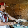 Globe/Roger Nomer<br /> Brett Macary shapes a bat at his home in Frontenac on Wednesday.