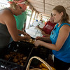 Globe/Roger Nomer<br /> Misty Phillips, of Misty Morning Farms, left, and Michaela Jones helps pack up food for Feed the Heart on Thursday at the Webb City Farmers Market.