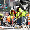 Road construction crews labor near 17th and Main streets during heat indicies well above triple digits on Tuesday afternoon as heat waves dominate the background.<br /> Globe | Laurie Sisk