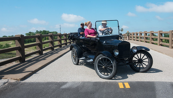 Globe/Roger Nomer<br /> (from left) David Berry, Galena building inspector, Tracy Roberts, Galena treasurer, and Lance Nichols, Galena mayor pro-tem, drive over the Galena viaduct in a 1919 Model T from the city's museum on Thursday.