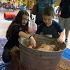Globe/Roger Nomer<br /> Aili McFall helps Hunter Lee, 5, with the potatoe dig on Saturday at the Freeman NICU reunion at the Joplin Convention and Trade Center. Both McFall and Lee are graduates of the Freeman NICU.