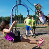 Globe/Roger Nomer<br /> Maci Jenkins, 6, left, and Hannah Ruvalcaba, 11, swing on Monday at Ewert Park.