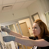 Globe/Roger Nomer<br /> Katie Warner, a RN in the Intensive Care Unit, checks an IV on July 5 at Mercy Hospital.
