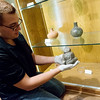 Globe/Roger Nomer<br /> Everett Bandy, tribal historic preservation officer, talks about a piece of Quapaw pottery on Friday at the Quapaw Tribal Museum.