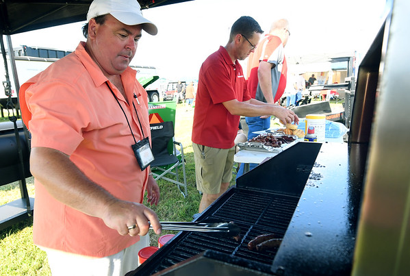 Curt Cain, of Beaver valley Supply cooks up free samples on a Louisianna Wood Pellet Grill during the first day of the Four States Farm Show on Friday in Pittsburg. The show continues through Sunday.<br /> Globe   Laurie Sisk