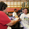 From the left: Volunteer Jan Burroughs hands fresh onions and cabbage to Sylvia Scanlan, of Joplin, during the Carterville Christian Church's Feed the Heart food pantry on Thursday night.<br /> Globe   Laurie Sisk