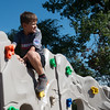 Globe/Roger Nomer<br /> Channing Bush, 7, checks out the view from on top of the new climbing wall at Ewert Park on Monday.