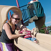 Globe/Roger Nomer<br /> Jessica Fletcher-Fierro takes her son James, 7 months, down the slide at Parr Hill Park on Monday.