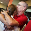 Globe/Roger Nomer<br /> Doug Kerr, Fresno, Calif., proudly greets his daughter Lindsay with a kiss following Monday's Kansas City University of Medicine and Biosciences White Coating Ceremony at Joplin High School.