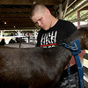 Fourteen-year-old David Russell, of Neosho, grooms his goat for showing on the first day of the Newton County Fair on Wednesday in Neosho.<br /> Globe | Laurie Sisk