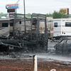 Globe/Roger Nomer<br /> Firefighters respond to a fire on Thursday at Wheelan RV Center on Rangeline.