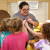 Camp Mintahama Director Rebecca Depriest is swamped by day campers as she visits the Camp Mintahama Dining Hall on Thursday.<br /> Globe | Laurie Sisk