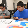 From the left: Andrew Summers, 14 and Jeronimo Cruz, 11, construct paper toads and owls at an origami station during the Joplin Public Library's celebration of the 20th Anniversary of the popular Harry Potter series of books and movies.<br /> Globe | Laurie Sisk