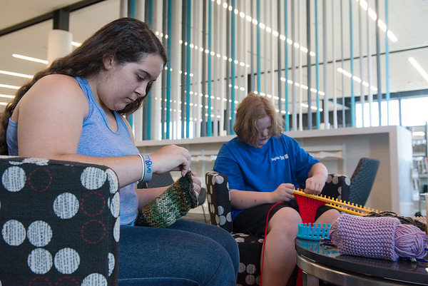 Globe/Roger Nomer<br /> Zoe Weston, 15, left, and Jackie Wiese, 12, knit on Monday at the Joplin Public Library.