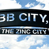 "A large sign proclaiming Webb City ""The Zinc City"" welcomes visitors to the Cardinal Route 66 Park before dedication ceremonies for the park in Webb City on Thursday. <br /> Globe 
